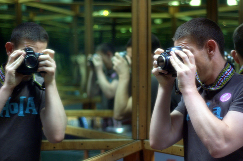 A photographer reflected in multiple mirrors